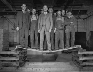 Men standing on plywood